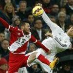 El vallecano Tito y el madridista Cristiano Ronaldo luchando un balón en el encuentro correspondiente a la 11ª jornada de Liga BBVA disputado el sábado 8 de noviembre de 2014